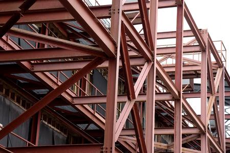 providing: Red iron beam construction providing maximum strength