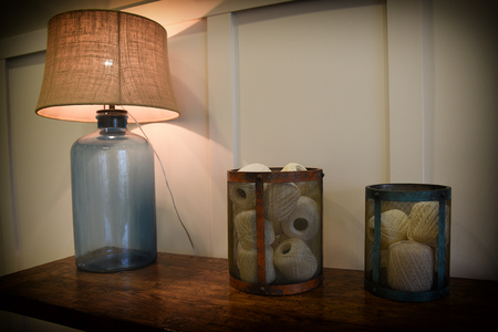 table lamp: Abstract of jug lamp and containers of string Stock Photo