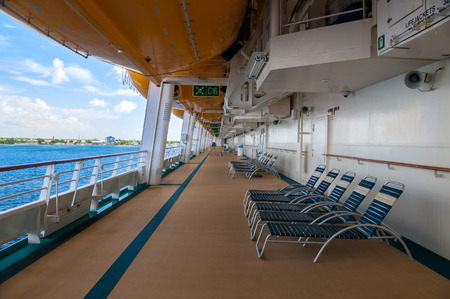 lifeboats: Promenade Deck showing life boats and blue water Stock Photo
