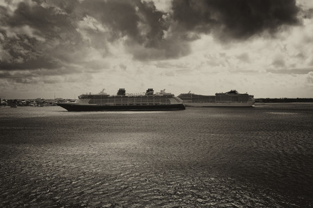 Two Cruise ships coming into port on a stormy tinted day