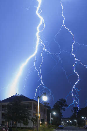 Very close dangerous and very massive lightning strike in a neighborhood Stock Photo