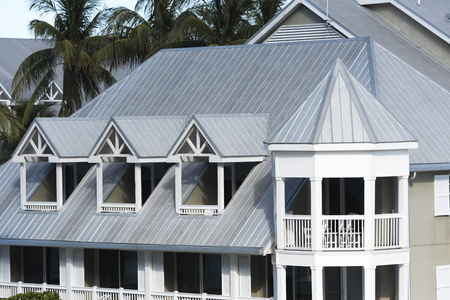 Steel roofing on modern apartment condo building for hurricane protection Archivio Fotografico