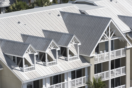 Steel roofing on modern apartment condo building for hurricane protection Stok Fotoğraf