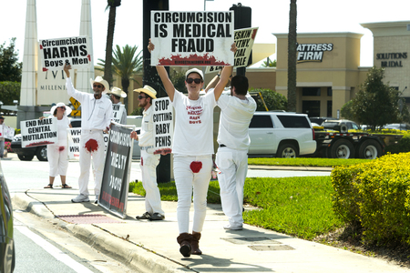 Orlando Florida - March 9th 2017: Public Protest of circumcision at the Millenia Mall entrance in Orlando, Florida, on March 9th, 2017