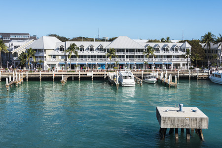 Key West Florida- February 12th, 2017:   Commercial pier and store fronts and docking facilities at Key West Florida February 12th, 2017