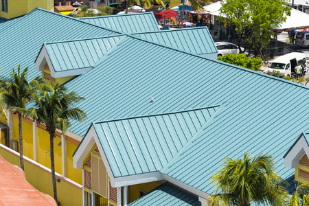 Steel roofing on modern apartment condo building for hurricane protection Stock Photo