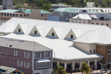 Steel roofing on modern apartment condo building for hurricane protection Editorial