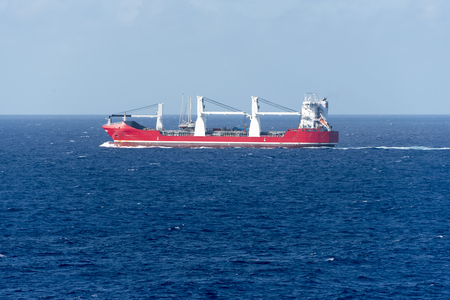 Red heavy lifting Construction Tanker at sea in the Bahamas