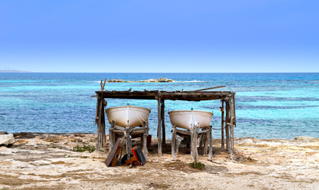 beached: two boats beached in formentera island, spain