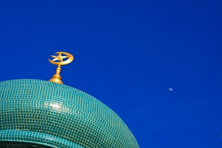 moon and top of the tiled dome of the ancient mosque in thailand  photo