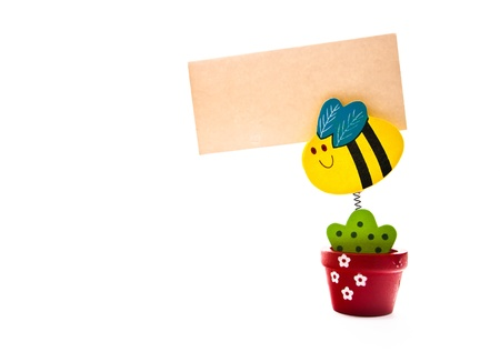 Wooden Flower Holds a Grunge  Note on a Isolated Stock Photo - 10356840