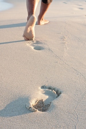Footprints on the beach left behind  photo