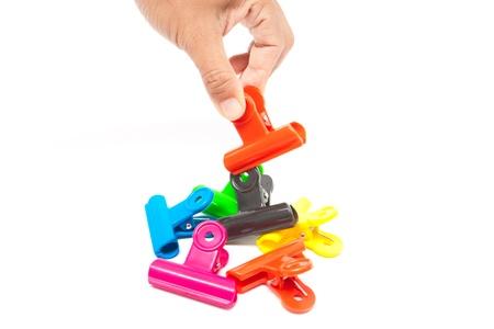 main ramasser clip en plastique coloré