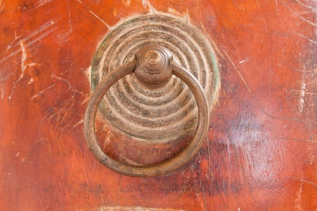 Ring handle made from metal on old big drum,Thailand.  photo