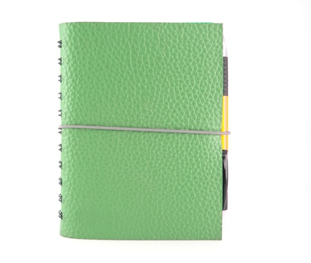 cover green leather notebook and pen isolated on white  photo