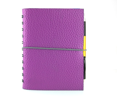 cover violet leather notebook and pen on white background  Stock Photo - 11111708