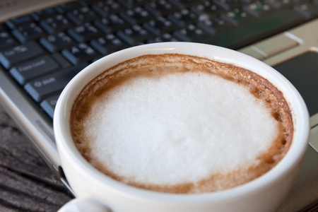 Laptop and coffee cup photo