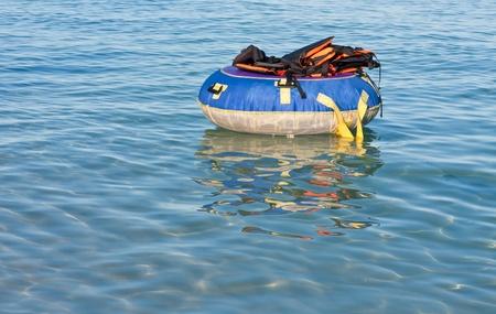 Group of life jackets on life buoy  photo