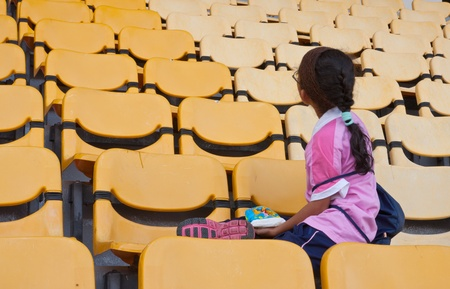 grandstand: Kid sit on yellow grandstand