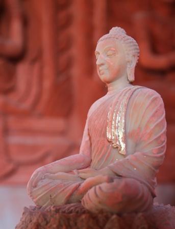 smilling: old smilling budha sitting in meditation pose  Stock Photo