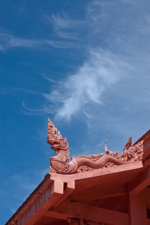 naka decortation on top of roof and abstract cloud,Thailand  Stock Photo - 11272351