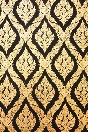 native thai painted pattern of textured wall in ancient buddhist temple photo