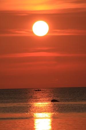 siluate et soleil couchant