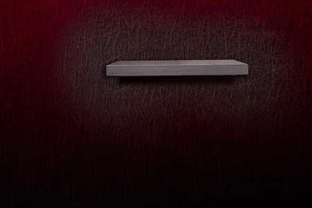 wooden shelf on leather wallpaper  photo