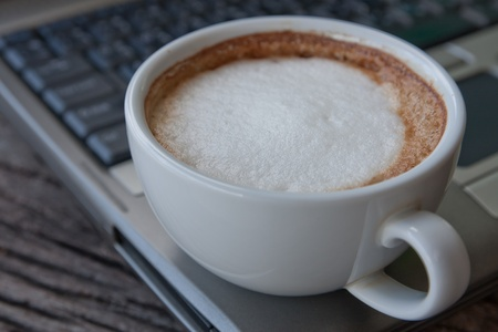 Laptop and coffee cup Stock Photo - 11707067
