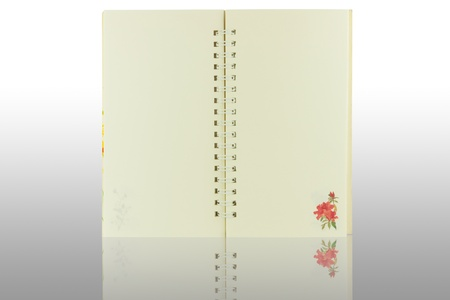 open Notebook with rose flower decoration Stock Photo - 11873384