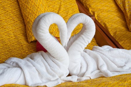 white heart towel decoration in Thai style hotel room Stock Photo - 11873393