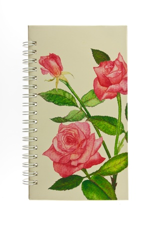cover notebook with rose pattern isolated photo