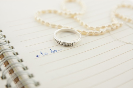 open notebook with wording to do and diamond ring...love concept Stock Photo - 12003074