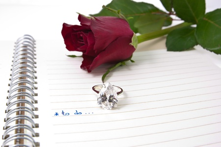 open notebook with wording to do and diamond ring...love concept photo