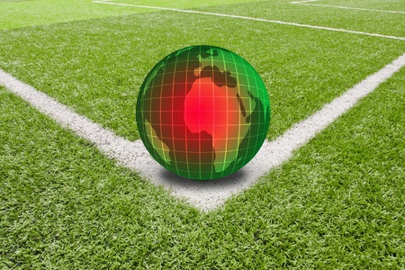 brazil globe on soccer field corner...world soccer 2014 photo