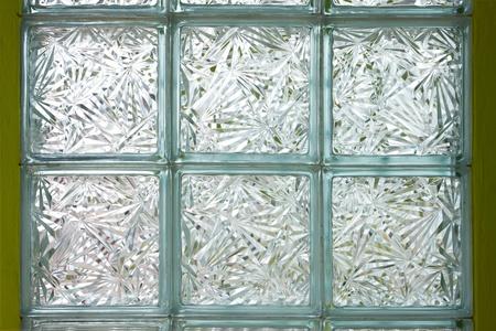 Glass box decoration on green wall background photo
