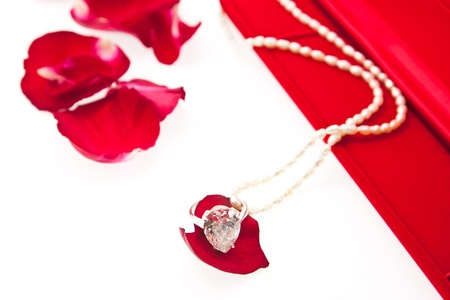 wedding ring and pearl necklace with red box photo