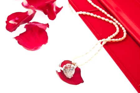 Diamond ring and pearl necklace with red box photo