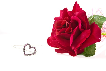 heart pendant with amethyst and red rose isolated on white background photo