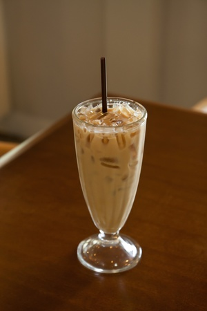 Iced coffee latte on wood table photo