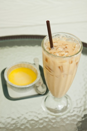 iced coffee latte and pumpkin custard  on glass table photo