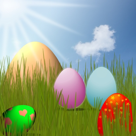 colorful Easter Eggs sitting on grass field with blue sky background photo