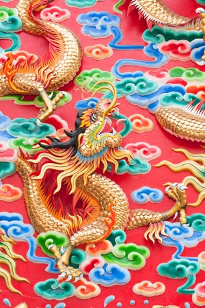 chinese dragon statue  on temple wall in Thailand Stock Photo - 13045630
