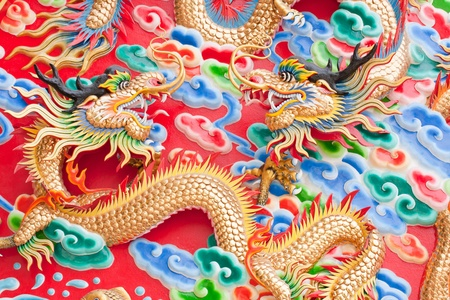 chinese dragon statue  on temple wall in Thailand Stock Photo - 13045640