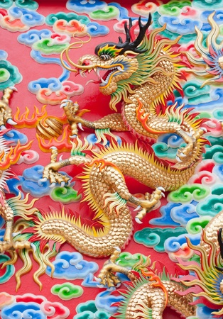 chinese dragon statue  on temple wall in Thailand Stock Photo - 13045620