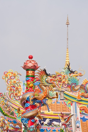 dragon statue on Thai-china temple roof