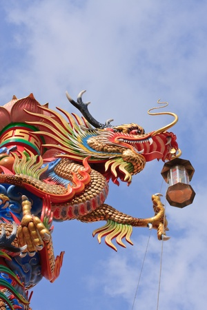 dragon statue on Thai-china temple roof photo
