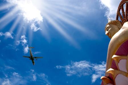 golden Big Buddha statue with airplane over blue sky in Samui island,Thailand photo