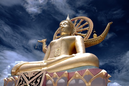 golden Big Buddha statue against blue sky in Samui island,Thailand photo