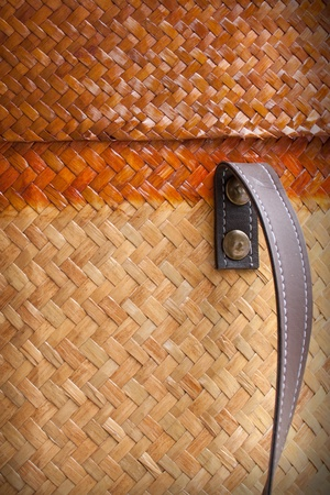 Steel botton and leather holder decorate on bamboo background Stock Photo - 13418287